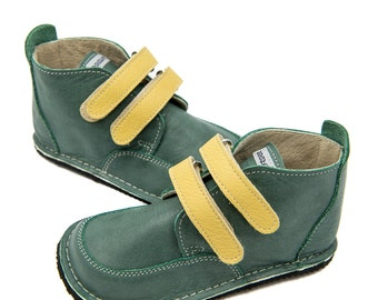 Green leather shoes,yellow details,leather lining,Vibram sole,velcro fastening/laces,support barefoot walking,sizes EU 21 to 31-US 6 to 12.5