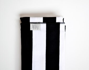 Black white baby swaddle blanket. Stripes, gender neutral, Soft stretchy knit.  Size 31 by 40 inches. Made by lippy brand.