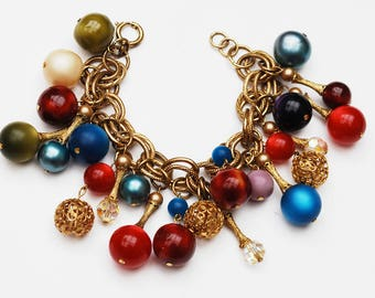Cha cha Bracelet - colorful Ball - Crystal - blue green red - Moon glow lucite - marbled plastic -  gold filigree  -  dangle Bangle