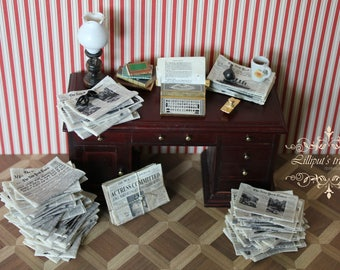 Dollhouse miniature stack of vintage newspapers