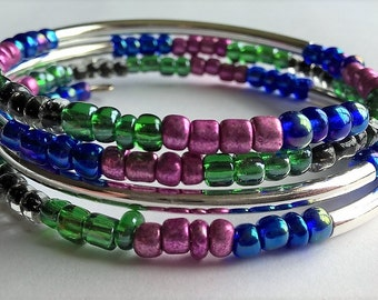 Memory Wire Bracelet: AB finished Blue, Pearly finished Magenta, Green, Black inside Clear Seed Beads, Silver plated Tube Beads