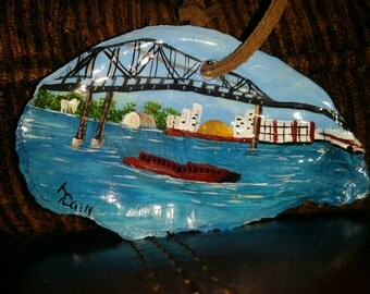 Oyster Shell featuring a Scene from the Mississippi River in New Orleans.