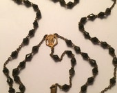 beautiful black faceted glass rosary with gold plated cross