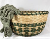 Large Toy, Laundry, or Quilt Hand Woven Reed or Wicker Storage Basket with Wood Base and Pottery Handles