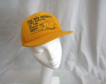 Retro Perverted Sex Joke Hat. Yellow Novelty Snapback Mesh Baseball Cap. I'm So Horny I Get Exited At The Crack of Dawn Novelty Sex Hat