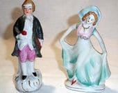 Two Porcelain Hand Painted Made in Japan Figurines - Colonial Man Holding Bouquet of Flowers and Art Nouveau Style Lady Dancing