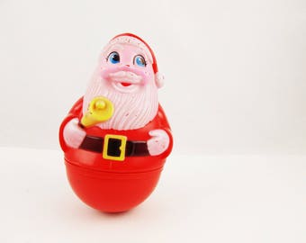 A  Roly-Poly Plastic Santa With Yellow Bell  - Hard Plastic With Hand-painted Face - Classic 1970s Decor