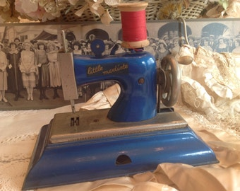 Adorable child's French antique sewing machine