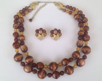 Vintage Art Mode Lucite Bead Double Strand Necklace and Clip On Earrings Set.