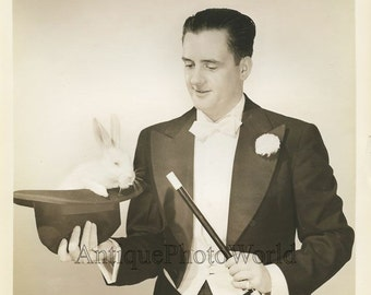 Handsome magician with magic wand and white bunny rabbit antique photo