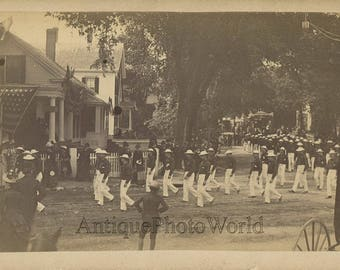 Parade men in costumes marching thru town Westfield Massachusetts antique photo