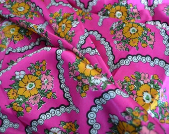 "1970's vintage silk satin fabric with floral print 3 yards 27"" by 44"" wide white black orange green pink on vibrant fuchsia pink backdrop"