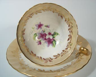 Vintage  Aynsley tea cup and saucer , Beige and gold tea cup set with Violets.