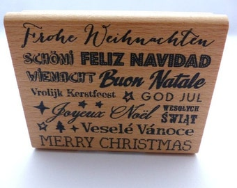 Stamped Merry Christmas in different languages text