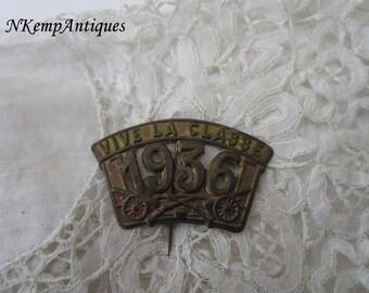 Old metal pin