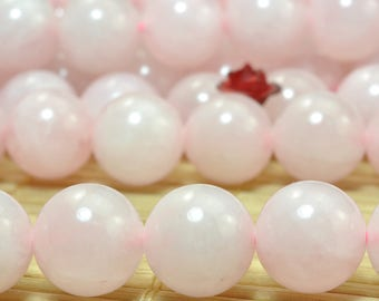 37 pcs of Natural Rose Quartz smooth round beads in 10mm