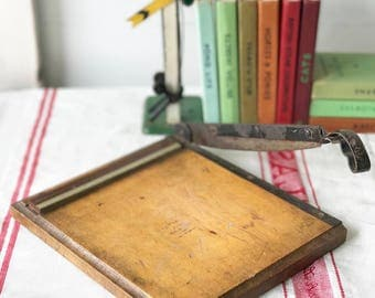 A lovely mini vintage paper cutter or office guillotine office stationery