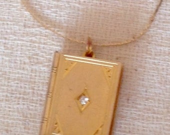 10K Gold and Diamond book locket. Engraved on back with which appears to be SS