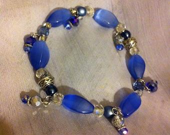 Blue mix stretch beaded bracelet with Celtic knot beads.