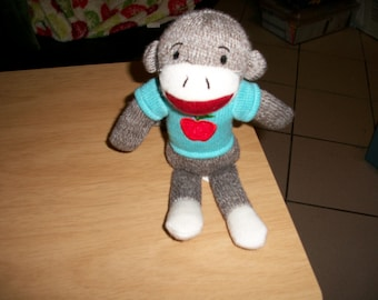 Sock monkey with Blue shirt with apple on it