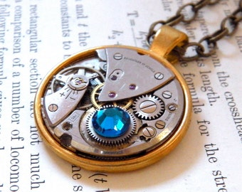 Steampunk Necklace, Featuring a Watch Mechanism & Blue Swarovski Crystal.