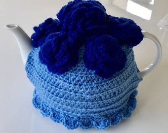 Crochet tea cosy light blue with dark blue flower detail