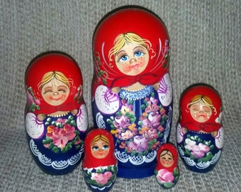 Girl in Different Moods on Five Russian Nesting Dolls.