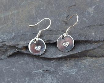 Heart stamped silver earrings