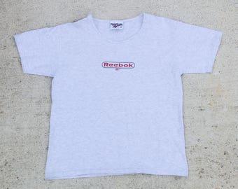 Vintage 90's Reebok Athletic Apparel Sports Minimal Logo Wide Neck Heather Grey Tee T Shirt Size Medium