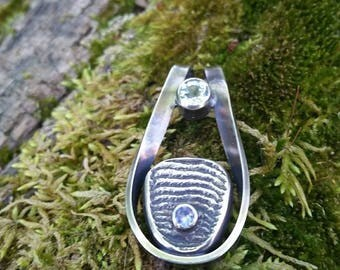 Water - cuttlebone casted and fabricated pendant featuring a beautiful aquamarine facet and tanzanite facet - all sterling silver