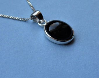 Jet pendant etsy whitby jet and sterling silver dainty pendant aloadofball Image collections