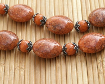 Chunky Orange or Rust Acrylic Beads with Metal Flower Caps