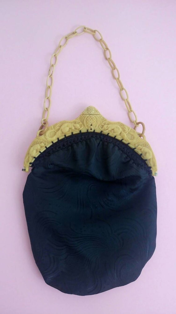 Retro Handbags, Purses, Wallets, Bags Vintage 1930s purse celluloid ornate clasp black silky brocade $29.46 AT vintagedancer.com
