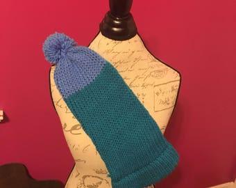 Multi blue winter hat with blue pom pom