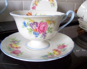 Vintage Shelley China Wide Brimmed Cup and Saucer Floral Bouquet pink roses blue yellow purple and white flowers