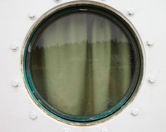 Fine Art Giclee print. Boat Ferry Port Hole photograph. Color. Circle window with curtain cover. White foreground with rusty accents.