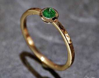 Rose gold ring with emerald