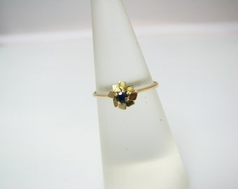 Sweet 18k Yellow Gold Flower Ring with Center Blue Stone