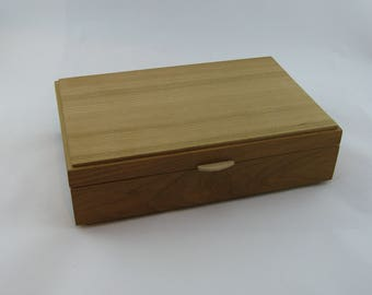 Jewelry box in cherry wood  12 X 7 3/4 x 3 1/8.Top is made from vertical grain ( quarter cut )