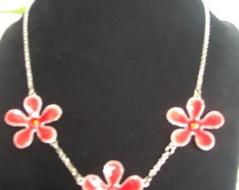 silver chain necklace with red flower