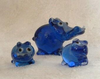 Three glass hippopotamus