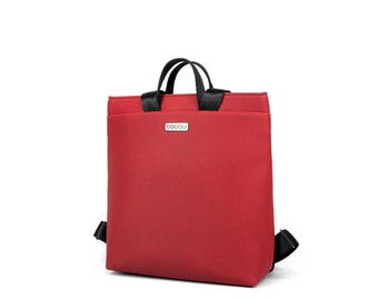 Small red backpack with light inside. 2 inside pockets and 1 outside pocket. Straps made of seatbelt - Boogie S