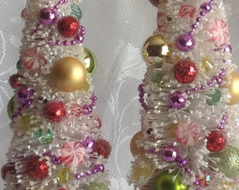 Set of two decorated bottle brush Christmas trees