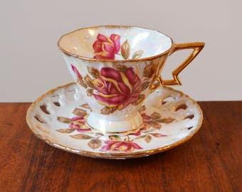 Royal Sealy Art Deco Iridescent Teacup and Saucer, with massive magenta roses - angular gold handle and reticulated saucer edge, Japanese