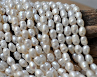 White Rice Shape Pearls 9-12mm size, drill size 2mm 15 inches strand