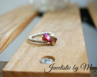 Elegant and sparkly silver plated fiery red crystals ring
