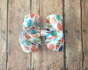 Colorful feather boutique bow