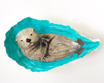 Baby Sea Otter, huge oyster shell