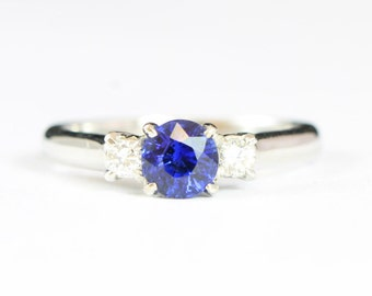Blue ceylon sapphire and diamond trilogy 3 stone engagement ring in 18 carat white gold for her handmade ring UK