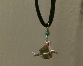 Sterling Silver Origami Paper Crane Charm Necklace on Black Velvet